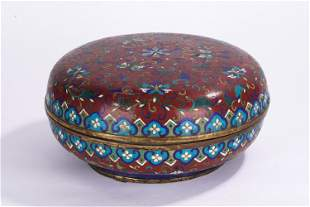 A CHINESE RED GROUND CLOISONNE CIRCULAR BOX AND COVER