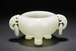 A CHINESE WHITE JADE TRIPOD CENSER WITH DOUBLE HANDLES