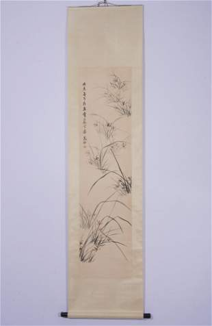 A CHINESE SCROLL PAINTING OF ORCHIDS