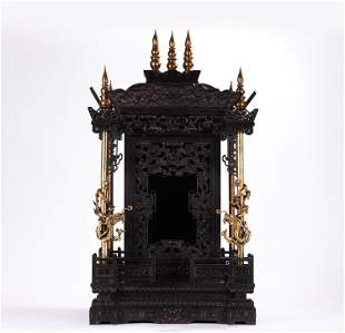 A CHINESE GILT AND ZITAN CARVED DRAGONS BUDDHA NICHE