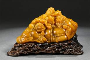 A CHINESE SOAPSTONE CARVED FIGURAL DECORATION