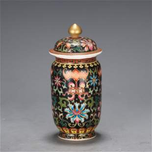 A CHINESE ENAMEL PAINTED PORCELAIN VASE AND COVER