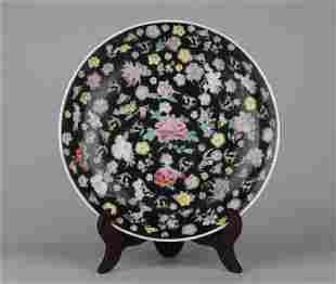 A CHINESE BLACK GROUND FAMILLE ROSE PORCELAIN DISH