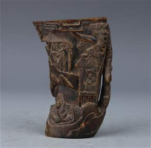 A CHINESE HORN CARVED FIGURES AND LANDSCAPE CUP