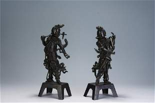 A PAIR OF CHINESE CARVED BRONZE MYTHICAL FIGURES