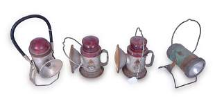 Group of four railroad battery powered hand lanterns