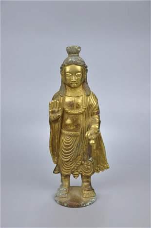 A Fine Gilt-bronze Standing Figure of Buddha