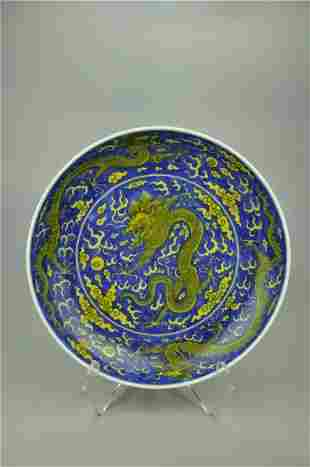 A Fine Yellow Glazed Blue and White 'Dragon' Dish