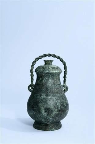 A Fine Bronze Handle Pot
