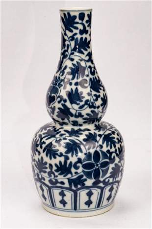 A Fine Blue and White 'Flower' Double-gourd Vase