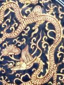 A Rare Blue Glazed Red-colored 'Dragon' Dish