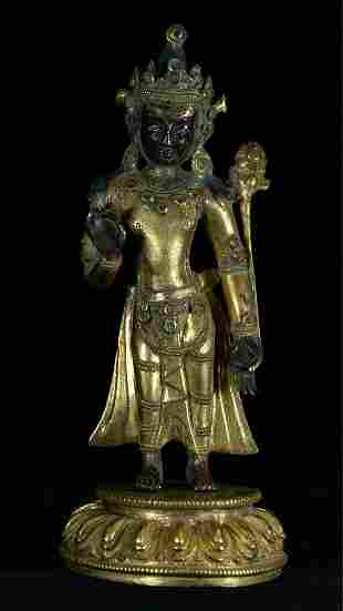 A Rare Gilt-Bronze Standing Figure of Guanyin with Gems