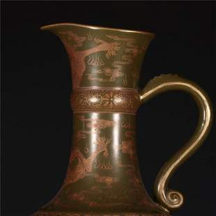A Rare Tea-dust Glazed Gold-painted 'Dragon' Ewer