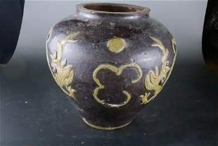 A Rare Red Earthenware 'Two Dragons' Pot