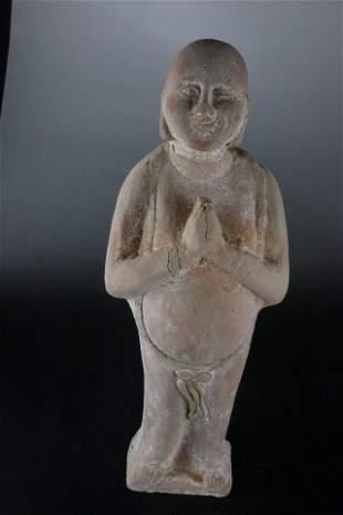 A Rare Earthenware Figure of Buddha