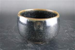 A Fine Black Glazed Alms Bowl