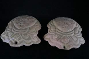 A Rare Pair of Earthenware Ornaments