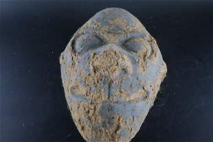 A Rare Earthenware 'Character' Mask