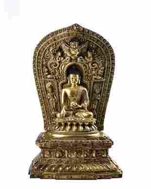 A Rare Gilt-bronze Figure of Medicine Buddha