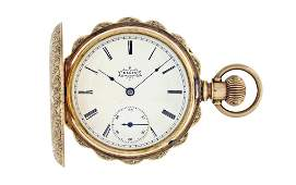 A decorative Elgin 14 karat gold pocket watch