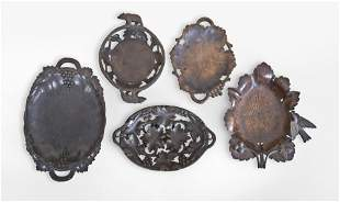 Lot of five carved linden Black Forest trays and bowls,