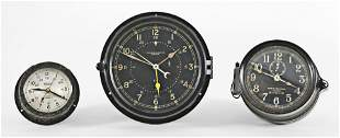 Three bakelite ships clocks