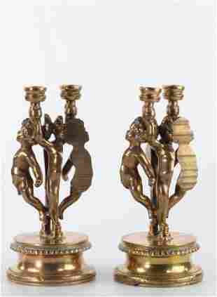 Arman Fernandez Angelots Pair of gilded candlesticks