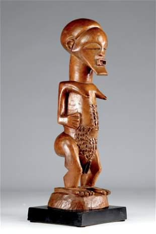 Rare feminine Luba Songye fetish wearing the kifwebe