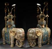 A PAIR OF GILT AND CLOISONNÉ ENAMEL ELEPHANTS , QING