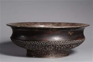 A Qing Dynasty Silver Inlaid Wood Tibetan Pot