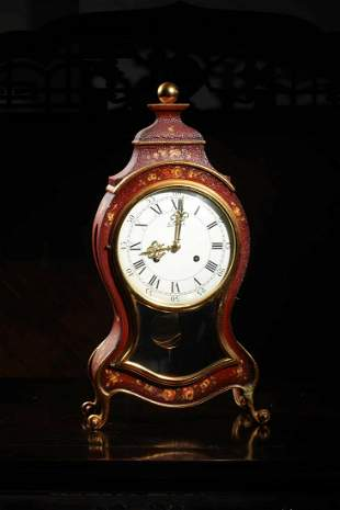A Gold Decorated Wood Octave clock