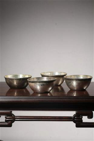 A Set of Four Sterling Silver Bowls