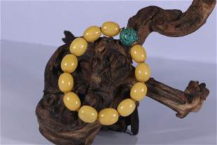 A Tibet Yellow Date Shaped Amber Turquoise Bead
