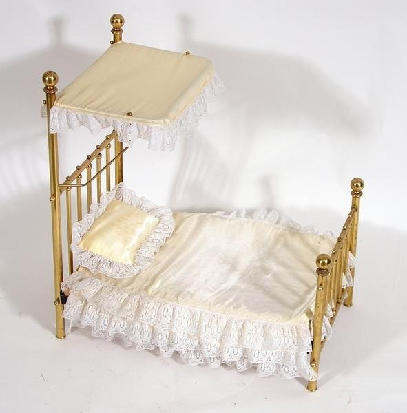 1: Vintage doll bed with brass like finish
