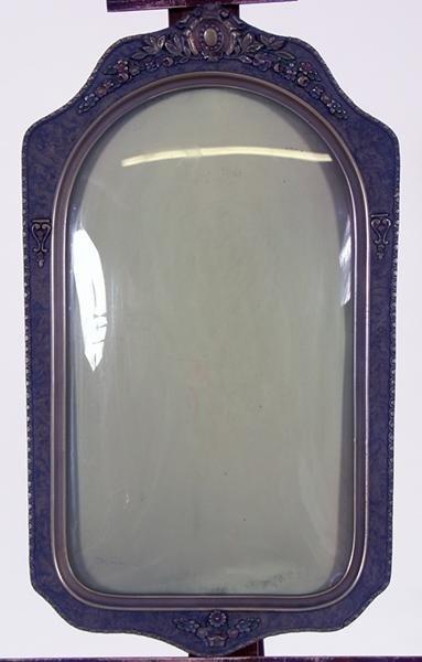 18: Ornate frame, bubble glass