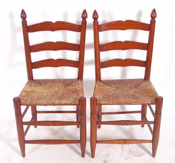 21: Lot of 2 rush bottom ladder back chairs