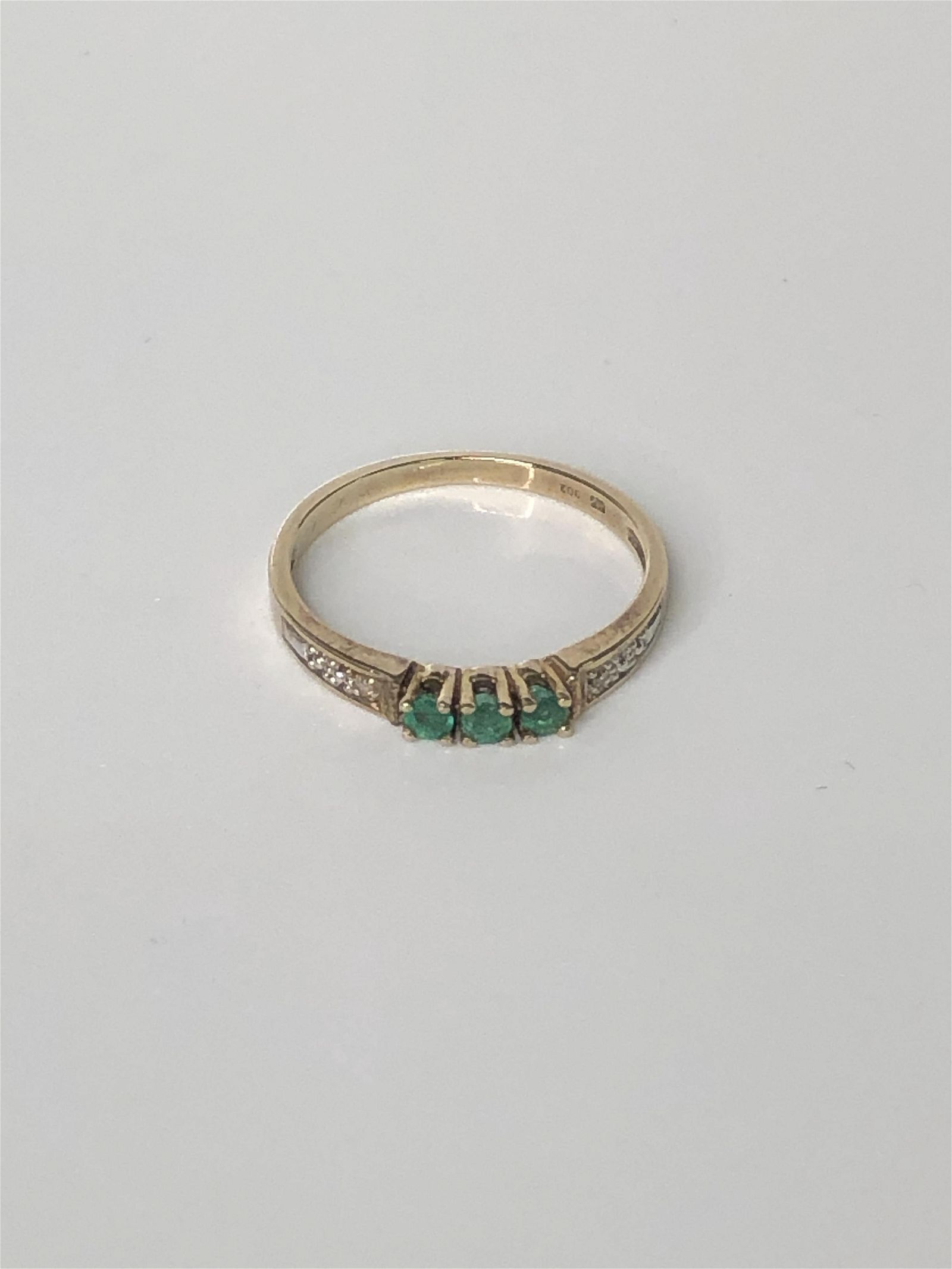 14 K Yellow Gold Emerald and Diamond Ring 1.76 grams,
