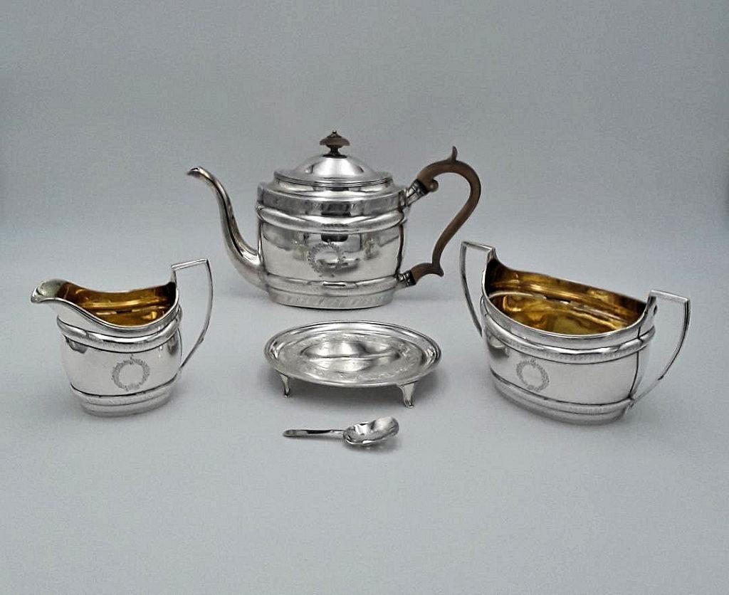 GEORGE III THREE PIECE SILVER TEA SET WITH TRIVET