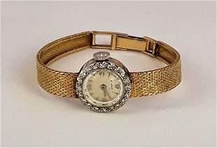 LADIES 14K GOLD AND DIAMOND WRISTWATCH