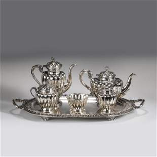 A SET OF SILVERWARE TEA SETS