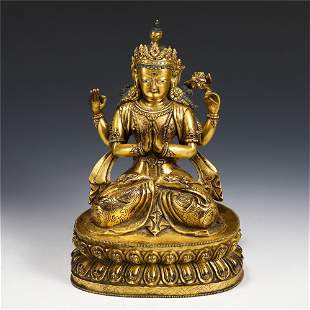 A CHINESE GILT BRONZE FIGURE OF FOUR ARMS SEATED