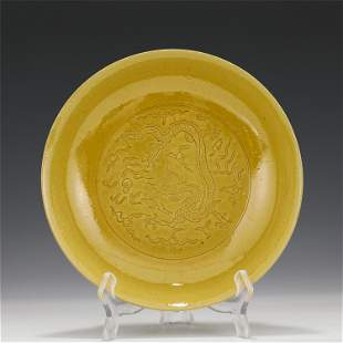 A CHINESE YELLOW GLAZED INCISED PLATE WITH DRAGON
