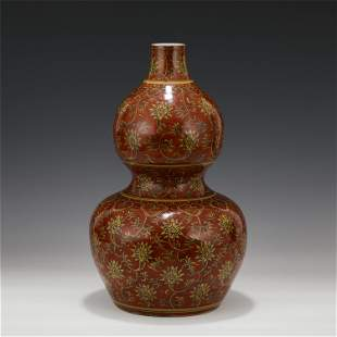 A CHINESE YELLOW GROUND RED GLAZE GOURD PORCELAIN