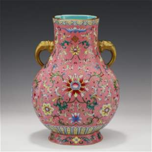 A CHINESE FAMILLE ROSE FLOWER DOUBLE ELEPHANT HANDLE