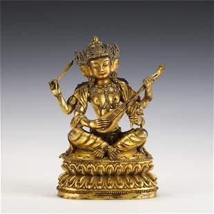 A CHINESE GILT BRONZE FIGURE OF BUDDHA SEATED STATUE