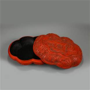 A CHINESE CARVED TIXI LACQUER FLOWER-SHAPED BOX
