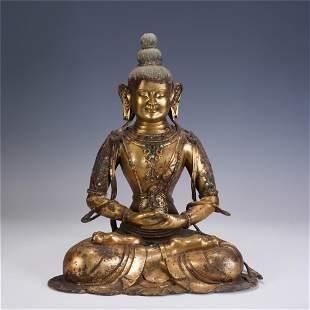 A CHINESE QING STYLE GILT BRONZE FIGURE OF BUDDHA