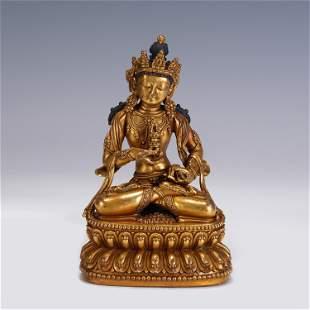 A CHINESE MING STYLE GILT BRONZE FIGURE OF BUDDHA