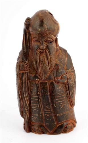 A CHINESE HORN CARVINGS FIGURE OF A GOD OF LONGEVITY