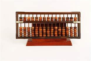 A HUANGHUALI WOOD ABACUS. MODEL AND BOX.M053.